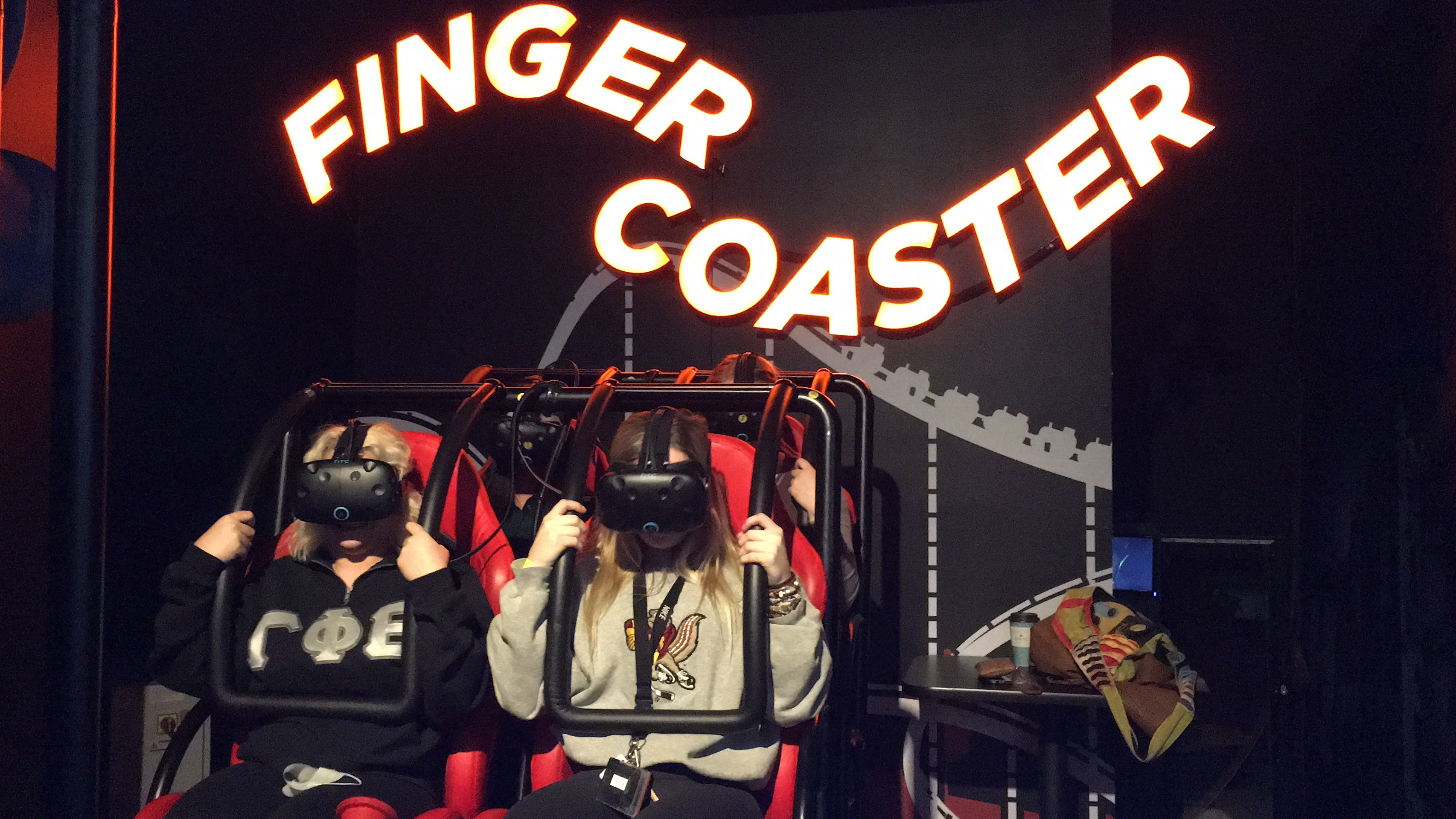 players riding finger coaster